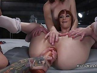 Lesbian slave gets deep anal penetration