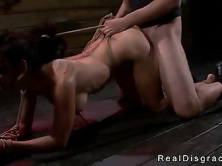 Tied to the floor by her wrists busty babe fucked