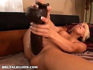 Desire has her pussy stretched to new limits by brutal dildos